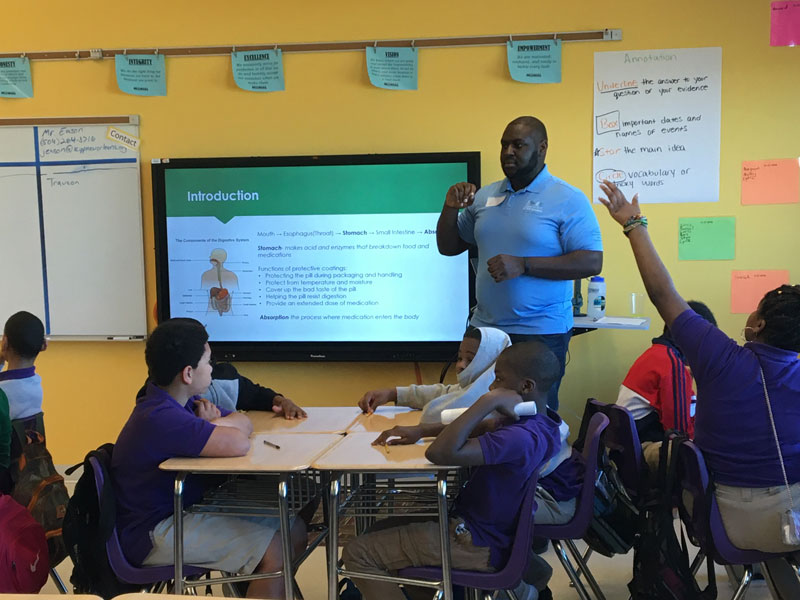 Graduate student leader teaching middle school students